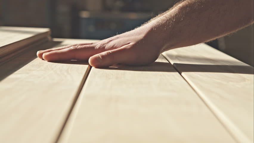 The young master hand touches the wooden boards in the sun. RAW video record. | Shutterstock HD Video #14773261