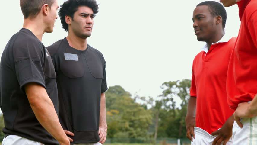 Rugby players talking to each other at the pitch