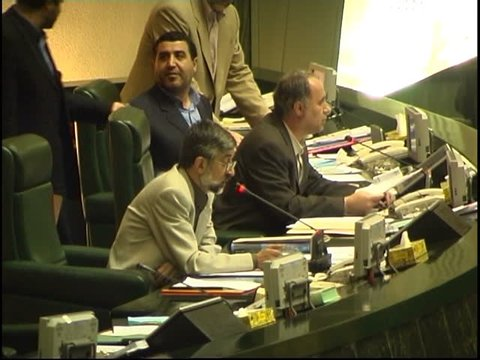 Parliament, Tehran, Iran - 2005 - Clip shows a group of Iranian MPs listening to Chairman, Mr. Gholam Ali Haddad Adel speaking in Persian (Farsi).
