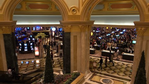 MACAU - 24 OCTOBER 2015: Entrance to the main betting and gambling hall of the Venetian Macao, one of the most popular gambling facilities and casino resorts in Macau and the world