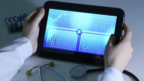 Epidemiologist investigating patterns of disease, comparing statistics on tablet