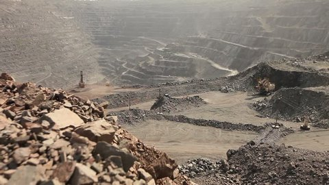 Heavy mining truck loaded with iron ore on the opencast, industrial exterior, quarry, mining of iron, quarry for the extraction of iron ore, open-pit iron ore mine showing, layers, mining  , ,