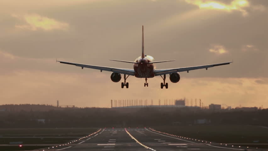 Airplane landing at big international airport | Shutterstock HD Video #14925601