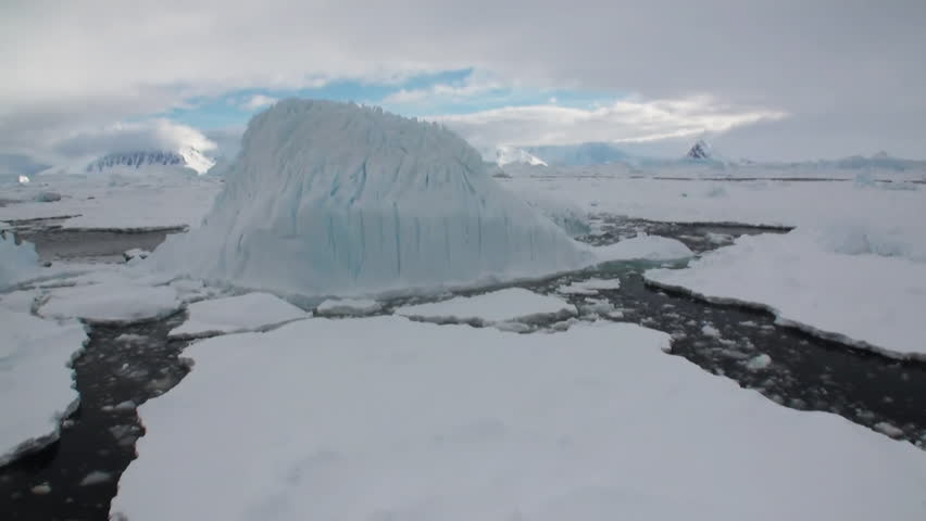 Ice and small icebergs floats on the ocean surface in the Antarctica. Amazing beautiful views of Nature and landscape of snow, ice and white of Antarctic. Global Warming.