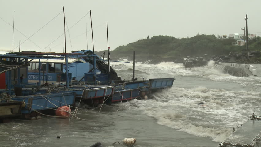 Hurricane Storm Surge Swamps Small Fishing Port. Footage of storm surge from category 5 typhoon wrecking havoc in a small fishing harbor. Shot in full HD on Sony EX1 XDCAM 1920x1080 30p - Usagi II