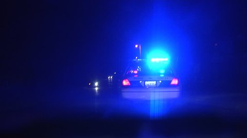 Police speeding to a scene at night