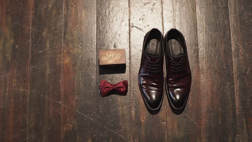 Man shoes, bowtie and box | Shutterstock HD Video #15064981