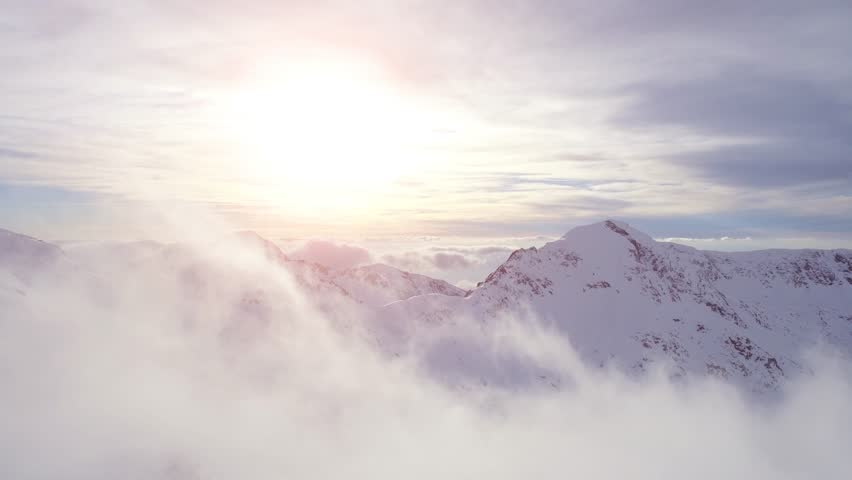 Aerial Flight Through Clouds Toward Sunset In The Mountains Winter Snow Landscape Inspirational Morning Sunlight Mist Inspiration Concept UHD 4K | Shutterstock HD Video #15072103