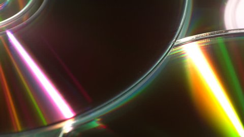 Moving reflected light beams effect on a set of CDs