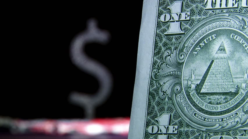 One dollar and symbol. US money. Shallow depth of field.