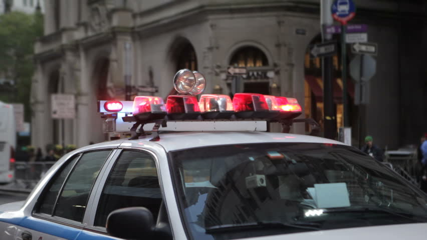 a NYC squad car with it's lights flashing at a check point in lower Manhattan near the 'occupy Wall st' protests, October 2011.