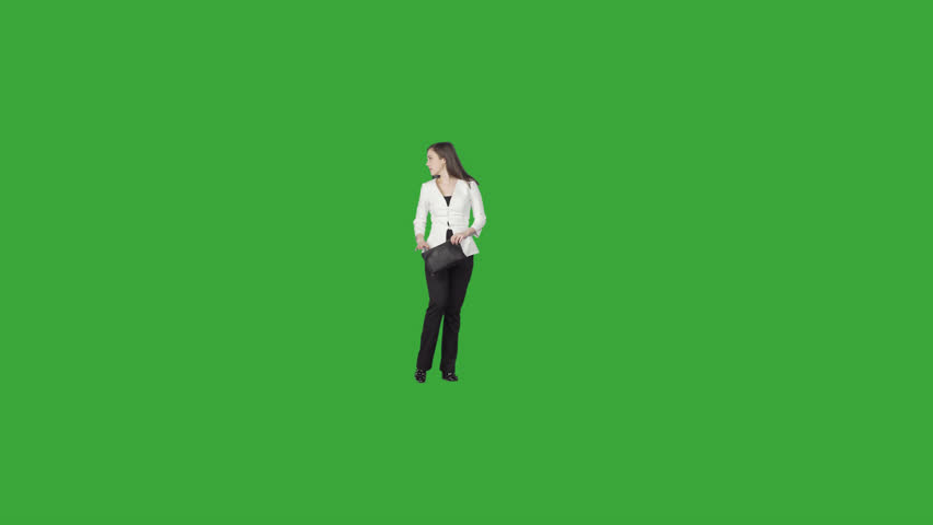 Elegant business woman in white suit jacket with clutch slowly steps & looks back Footage on transparent background. File format - .mov, codec PNG+Alpha. Shutter angle -180 (native motion blur)