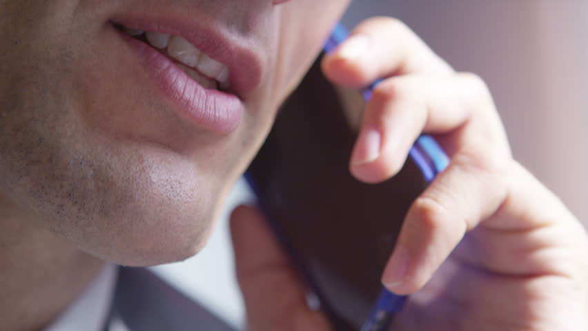 4k Extreme close-up of businessman talking on mobile phone | Shutterstock HD Video #15131521