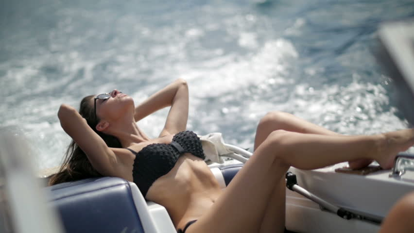 Woman relaxing on a luxury yacht