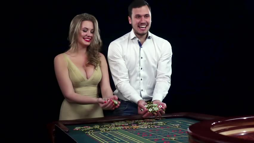 Winning's couple throwing chips in the air. Black   Shutterstock HD Video #15135595