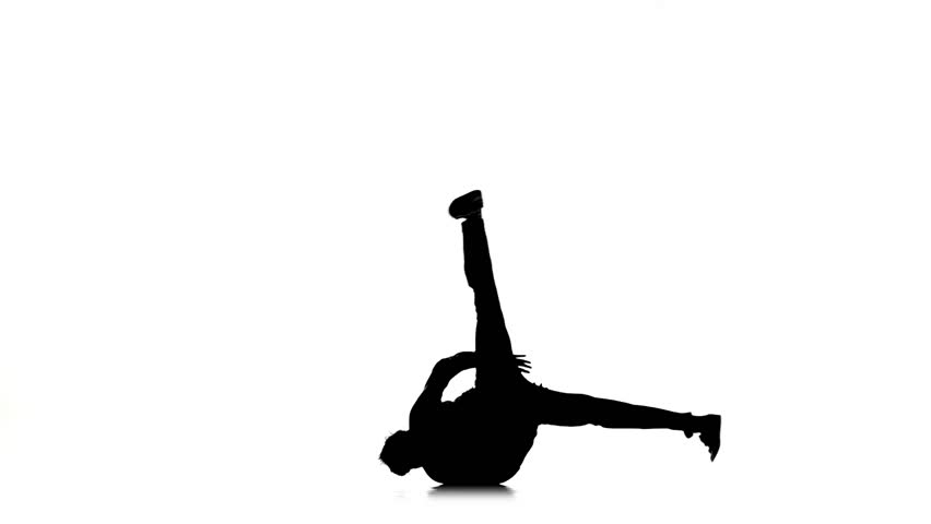 Young dancer man dancing breakdance on white, silhouette, slow motion