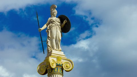 4K 25p Greek Goddess Athena statue timelapse..Shield and spear in hand standing on a tall pillar.Bright blue clear sky and clouds.All unwanted elements like birds,planes, have been digitally removed.