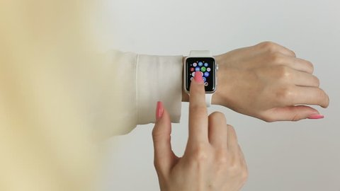 BANGKOK, THAILAND -MAY 7, 2015: close up image of the new apple watch sport on woman wrist on MAY 7, 2015 in Bangkok Thailand
