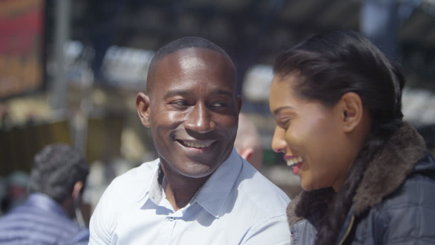 4k Happy attractive ethnic couple using computer tablet outdoors in the city | Shutterstock HD Video #15193141