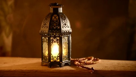 Traditional Ramadan lantern and Islamic rosary. Islamic festive background.