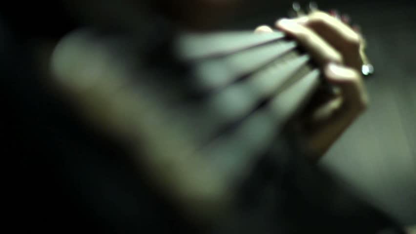 Man playing electrical bass guitar
