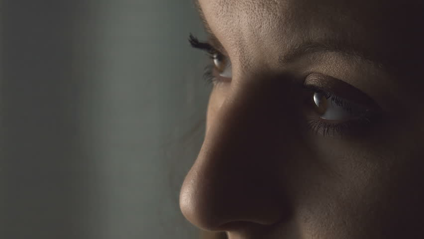 Sad young woman opens eyes; sad and melancholy look, closeup portrait | Shutterstock HD Video #15218392