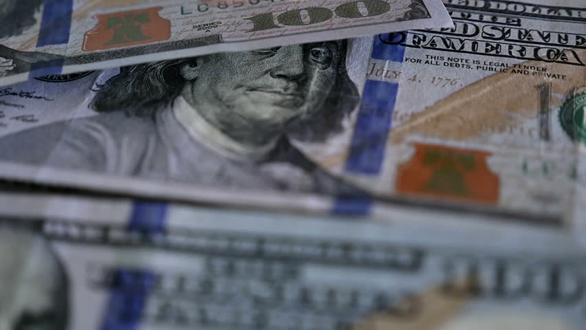 Close up of male hand picking up $100 bills one by one in slow motion. Shot with a Panasonic GH4 with a 12-35 mm 2.8 lens on white background.     Shutterstock HD Video #15238021