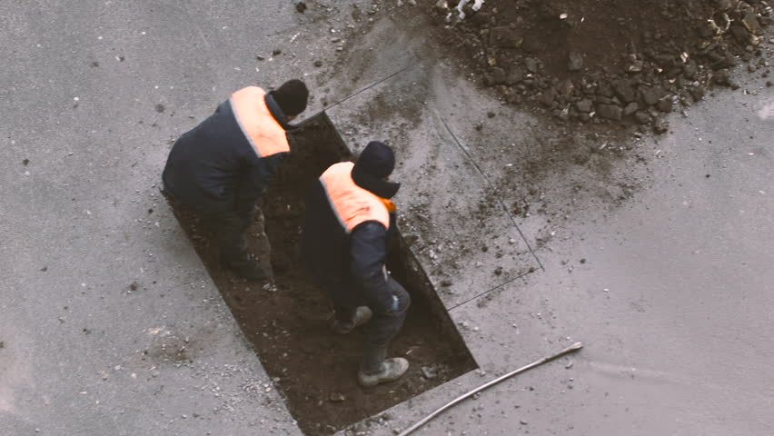 Two Workers Shovel Rake Land of the Hole Under the Asphalt, the Asphalt is Cut, the Workers in the Form of Construction Tools, Road Repair, Road Maintenance, | Shutterstock HD Video #15249211