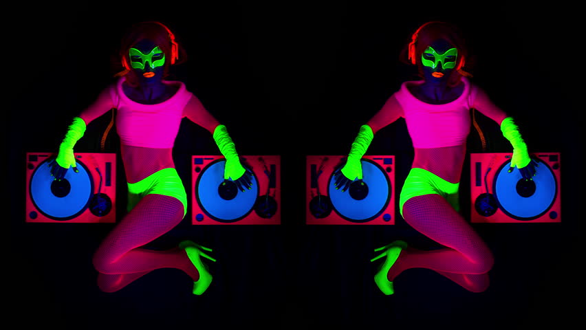 4k sexy female DJ mixes in a club in UV fluorescent costume. stylish,  cool and unique clip for events, parties and shows