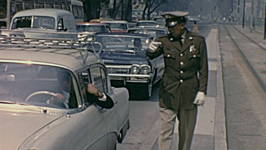 MEXICO CITY - JUNE 1965: policeman in the street   Shutterstock HD Video #15320041