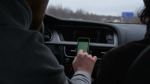 Driver use phone while driving to check the way on GPS. Shoot with RED EPIC