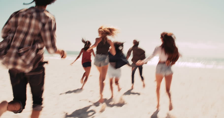 Multi-Ethnic group of road trip friends jumping out of retro van barefoot and running at sunny sandy beach | Shutterstock HD Video #15333199
