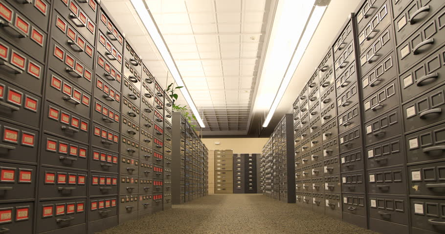 Tracking shot by old filing cabinets in a library. / Pittsburgh, PA - USA, May, 2015