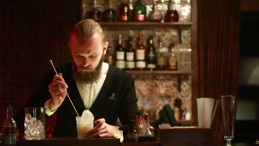 Handsome barman professional at posh bar making cocktail drinks #15359698