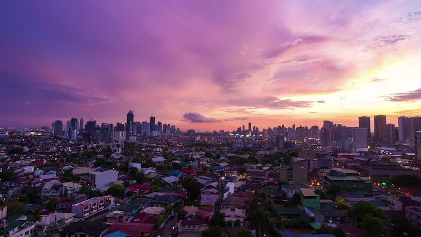 Zoom out timelapse of twilight over Metro Manila transitioning to night, Philippines | Shutterstock HD Video #15383524