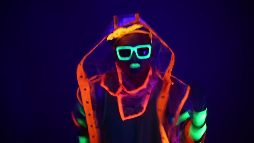 Guy dancing in neon costume
