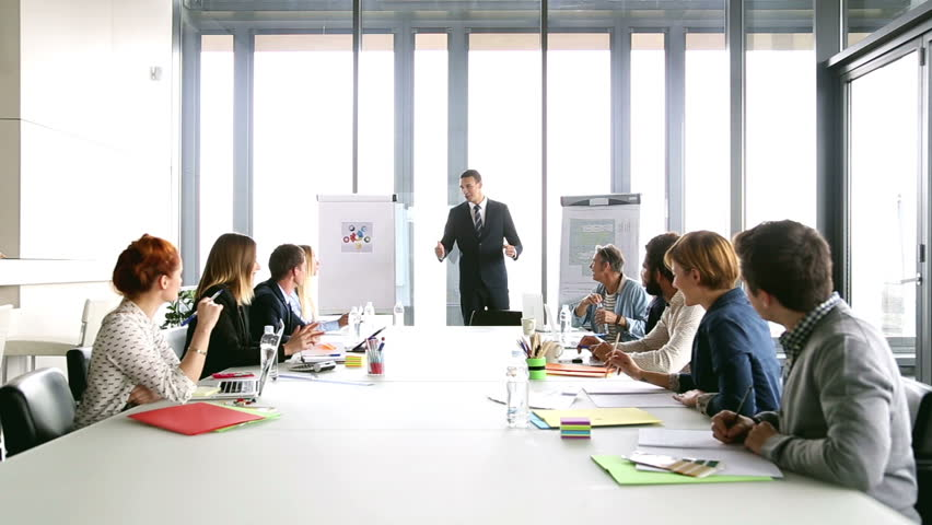 Business people applauding director during a meeting in conference room, graded | Shutterstock HD Video #15414808