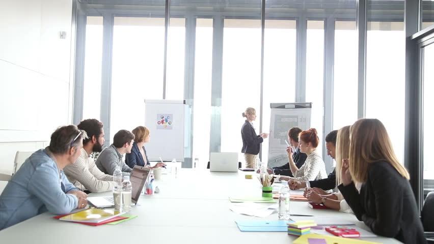 Young beautiful businesswoman giving presentation using flipchart | Shutterstock HD Video #15415261