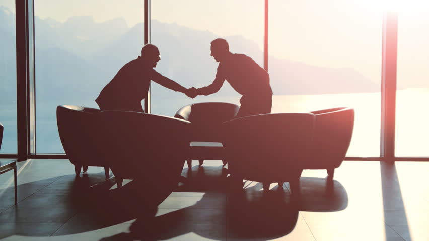Business meeting of two professionals in modern lobby lounge at sunset. panoramic window view background | Shutterstock HD Video #15415501