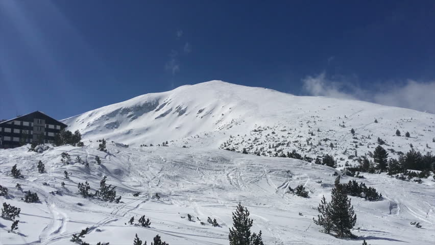 Bezbog Peak and Bezbog hut in Pirin Mountains in Bulgaria. A view from the ski lift. The hut is located at 2240 meter above sea level in ski resort Dobrinishte. Near by the famous ski resort - Bansko.