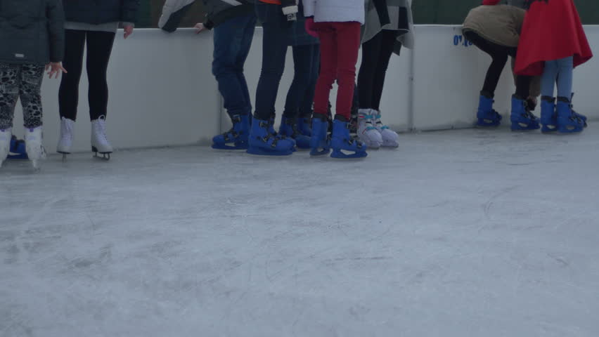 Group of teenagers resting near the ie skating rink boarding, at  an open air skate park. | Shutterstock HD Video #15460591