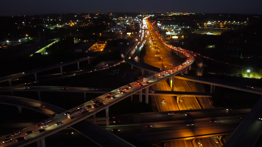 Atlanta Aerial v231 Panning down to vertical shot over Spaghetti Junction freeways following at night, pan up.