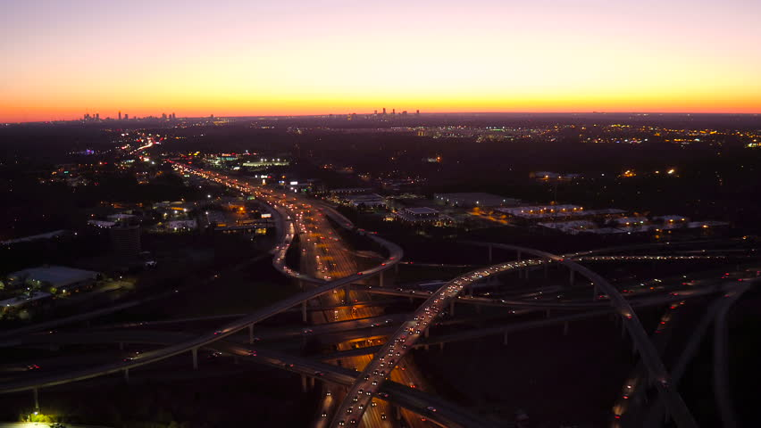 Atlanta Aerial v227 Flying low over Spaghetti Junction freeways panning down with cityscape dusk views.
