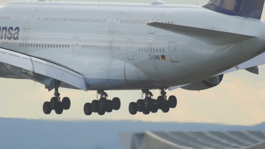FRANKFURT AM MAIN, GERMANY - SEPTEMBER 4, 2015: Lufthansa Airbus 380 Superjumbo landing, slow motion. Unofficial spotting on Sep. 4, 2015