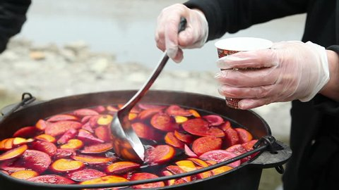 Cast iron pot with mulled wine. Russian holiday Maslenitsa