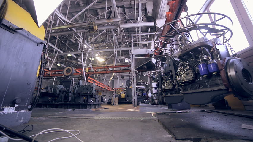 Car engine in Modern plant, industrial factory inside.