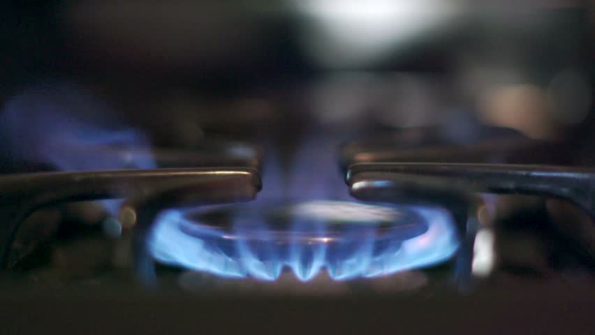 Stove top burner igniting into a blue cooking flame in slow motion 180fps. See my portfolio for other angles and slow motion speeds (60fps-180fps), including 4K UHD. | Shutterstock HD Video #15548887