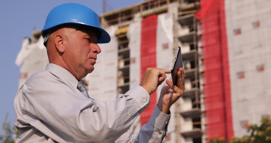 Engineer man checking examine blueprint architecture plan building industry investor checking technical plans use touch tablet connection ultra high definition ultrahd malvernweather Images