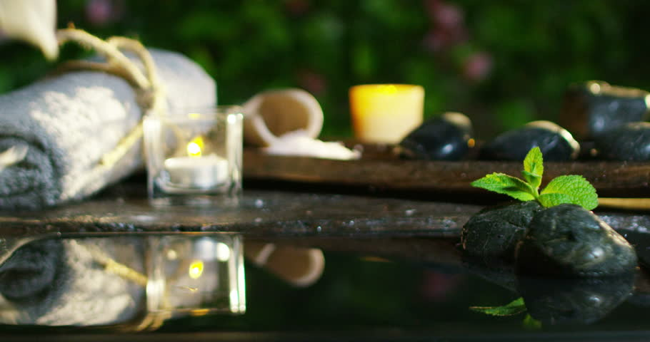 beautiful water and candles spa and wellness composition shoot in extreme slow motion
