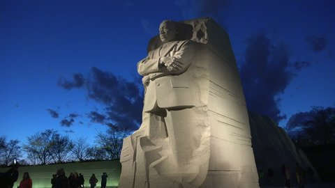 WASHINGTON, DC - MARCH 2016: Under awesome dusk sky, Martin Luther King Memorial, tilt up. Inscription Wall and tourists in background. MLK Memorial opened August, 2011 and can be visited at night.